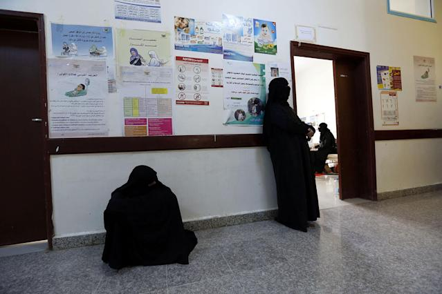 <p>Yemeni women wait for their cholera-infected relatives receiving treatment at a hospital amid a serious cholera outbreak in Sana'a, Yemen on June 22, 2017. (Yahya Arhab/EPA/REX/Shutterstock) </p>