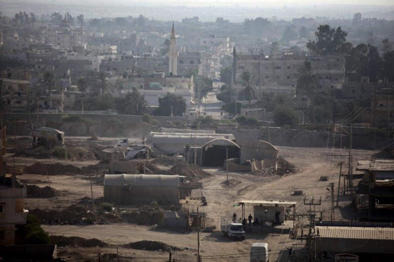 A smuggling tunnel area is seen along the Egypt-Gaza border as seen from Rafah, southern Gaza Strip, Sunday, Sept. 1, 2013. Egypt's military bulldozed 13 homes along the Gaza Strip border and caved in tunnels beneath them as a prelude to the possible creation of a buffer zone to reduce weapon smuggling and illegal militant crossings, angering residents who said they were evicted with no compensation, security officials and residents said Sunday. (AP Photo/Hatem Moussa)