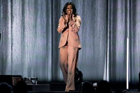Former first lady Obama claps at Royal Arena during book tour in Copenhagen