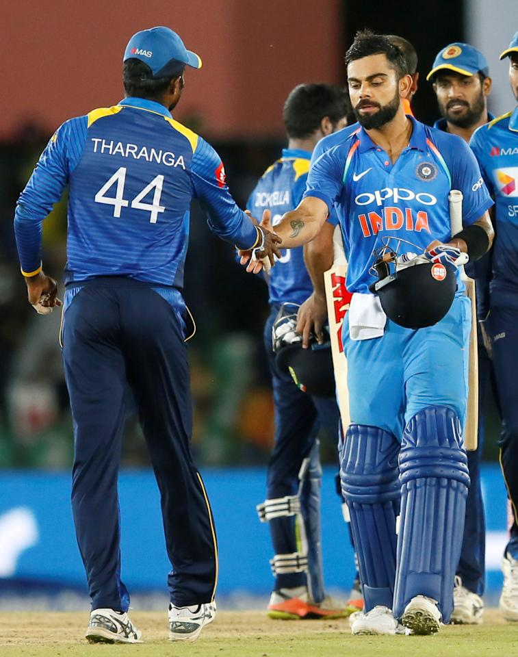 <p>India's captain Virat Kohli shakes hands with Sri Lanka's captain Upul Tharanga after India's victory. REUTERS/Dinuka Liyanawatte </p>