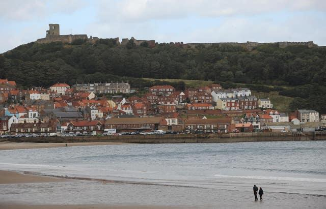 People on South Bay beach at Scarborough (Anna Gowthorpe/PA)
