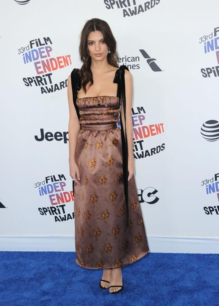 <p>Appearing on her first red carpet since her surprise wedding, the model chose a demure satin gown with bow straps. (Photo: Getty Images) </p>