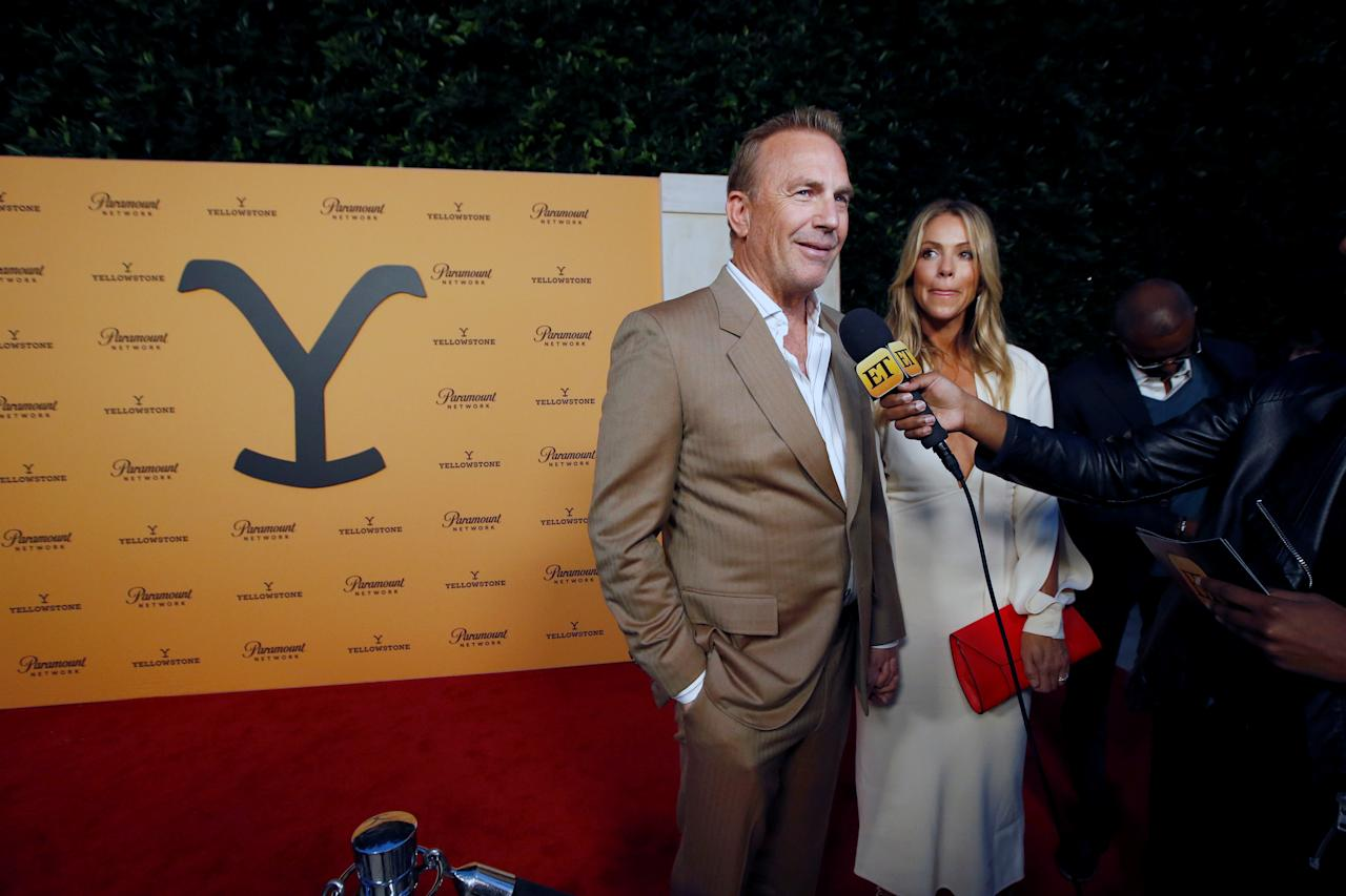 """Cast member Kevin Costner and his wife Christine Baumgartner are interviewed at a premiere party for season 2 of the television series """"Yellowstone"""" in Los Angeles, California, U.S., May 30, 2019. REUTERS/Mario Anzuoni"""