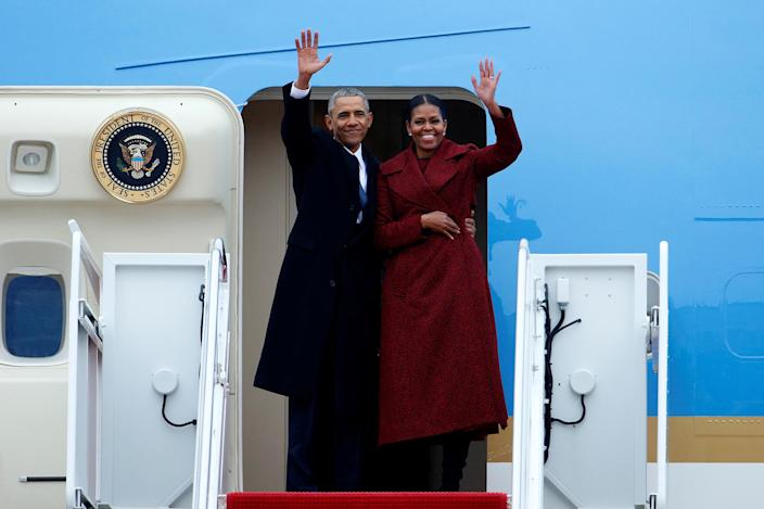 <p>Former president Barack Obama waves with his wife Michelle as they board Special Air Mission 28000, a Boeing 747 which serves as Air Force One, at Joint Base Andrews, Md., on Jan. 20, 2017. (Photo: Brendan McDermid/Reuters) </p>