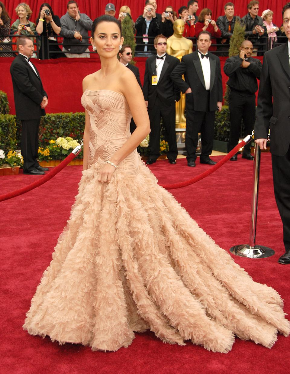 <p>Cruz's blush Versace gown featured a drop waist and an elaborate feathered skirt that turned heads and sent photographers into a frenzy. Although she didn't take home the Best Actress award that year, this look was by-far the red carpet winner of the night.</p>