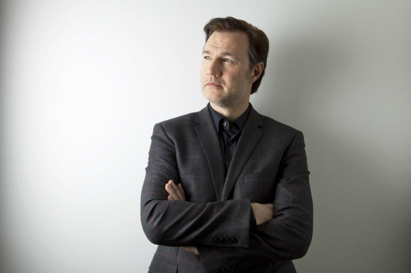 """This Jan. 28, 2013 photo shows actor David Morrissey from AMC Network's """"The Walking Dead"""", poses for a portrait in New York.  The popular zombie series returns for another eight episodes Sunday at 9 p.m. EST. (Photo by Amy Sussman/Invision/AP)"""
