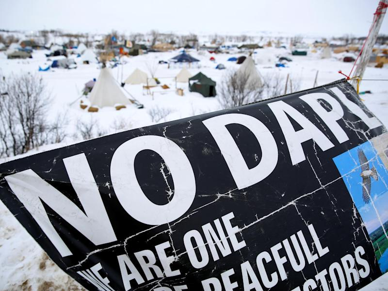 A banner flies in the Dakota Access Pipeline protest camp near Cannon Ball, North Dakota: Terray Sylvester/Reuters