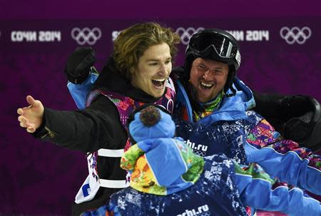 Switzerland's Podladtchikov celebrates with team mates during the men's snowboard halfpipe final event at the 2014 Sochi Winter Olympic Games, in Rosa Khutor