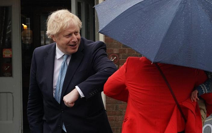 Prime Minister Boris Johnson meets a local after visiting a pub in Harlepool where hen was visiting and newly elected MP Jill Mortimer following Mher victory in the Hartlepool parliamentary by-election. Picture date: Friday May 7, 2021. PA Photo. S - Owen Humphreys/PA Wire