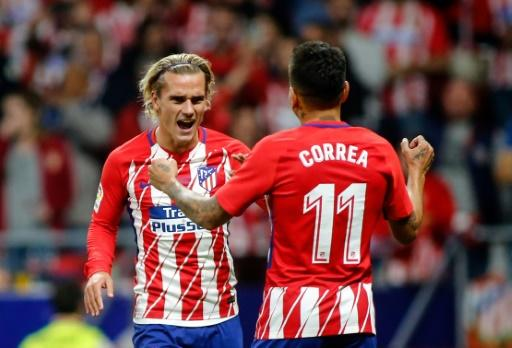 Atletico Madrid's forward Antoine Griezmann (L) celebrates with Atletico Madrid's forward Angel Correa (R) after scoring during the Spanish league football match against Malaga September 16, 2017