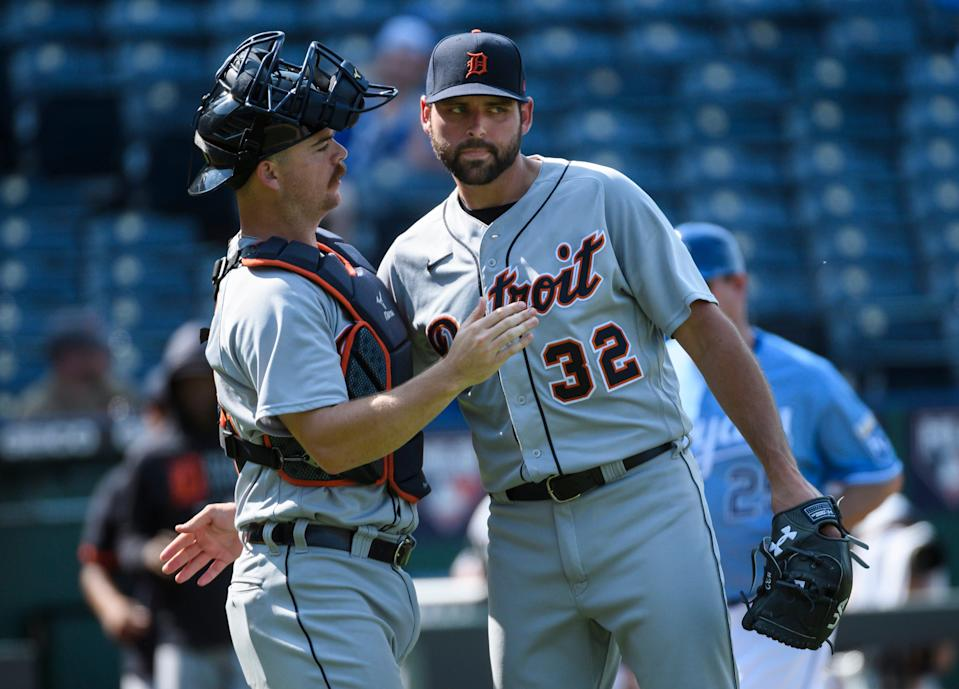 Detroit Tigers relief pitcher Michael Fulmer, right, is congratulated by Jake Rogers after their win against the Kansas City Royals at Kauffman Stadium in Kansas City, Missouri, on Wednesday, June 16, 2021.