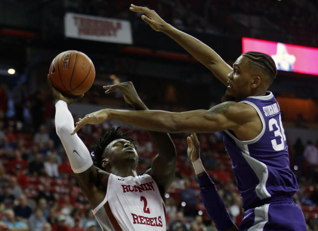 Kansas State's Levi Stockard III, right, guards UNLV's Donnie Tillman (2) during the first half of an NCAA college basketball game Saturday, Nov. 9, 2019, in Las Vegas. (AP Photo/John Locher)