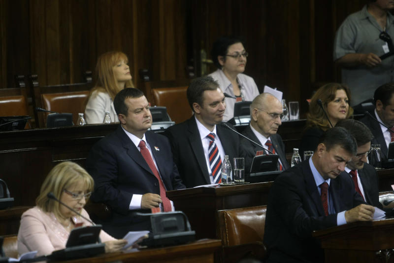 Serbia's prime minister designate, Ivica Dacic, 3rd left, and other members of the potential governmnet, attend a session of the Serbian parliament in Belgrade, Serbia, Thursday, July 26, 2012. Dacic, the wartime spokesman of late strongman Slobodan Milosevic, who has shifted away from the former patron but has also kept some of his trademark features, is set to become Serbia's new prime minister on Thursday, triggering unease despite his proclaimed pro-EU policies. (AP Photo/ Marko Drobnjakovic)