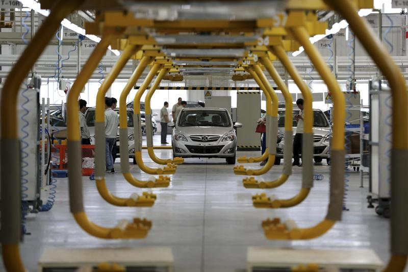 An E150 EV electric car is seen along a production line at a factory of Beijing Automotive Industry Holding Co (BAIC) on the outskirts of Beijing