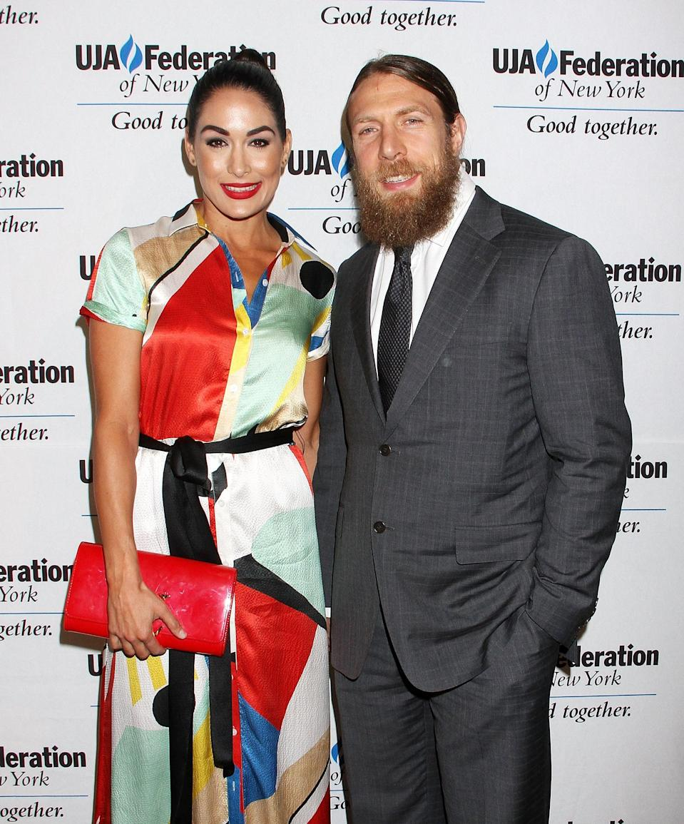 "<p>In January, the former wrestler announced that she is <a href=""https://www.popsugar.com/celebrity/brie-bella-and-nikki-bella-are-pregnant-47159270"" class=""link rapid-noclick-resp"" rel=""nofollow noopener"" target=""_blank"" data-ylk=""slk:expecting her second child with husband Daniel Bryan"">expecting her second child with husband Daniel Bryan</a>. Brie and Daniel welcomed their first child, <a href=""https://www.popsugar.com/celebrity/Brie-Bella-Gives-Birth-First-Child-43523895"" class=""link rapid-noclick-resp"" rel=""nofollow noopener"" target=""_blank"" data-ylk=""slk:a baby girl named Birdie"">a baby girl named Birdie</a>, in May 2017. Her due date is only a week and a half apart from her twin sister, Nikki. </p>"