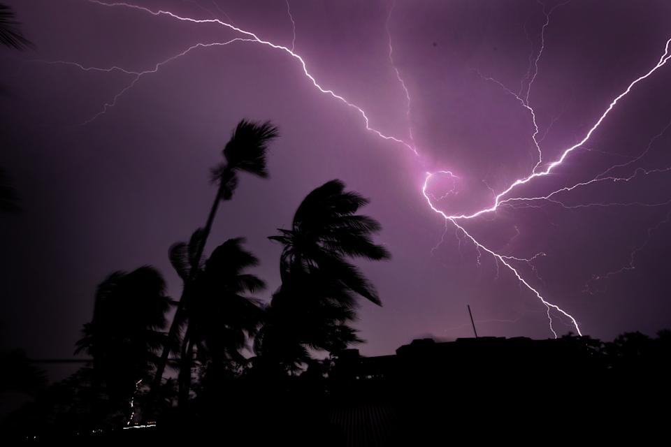 Lightning strike in the late evening with strong wind and heavy rain.