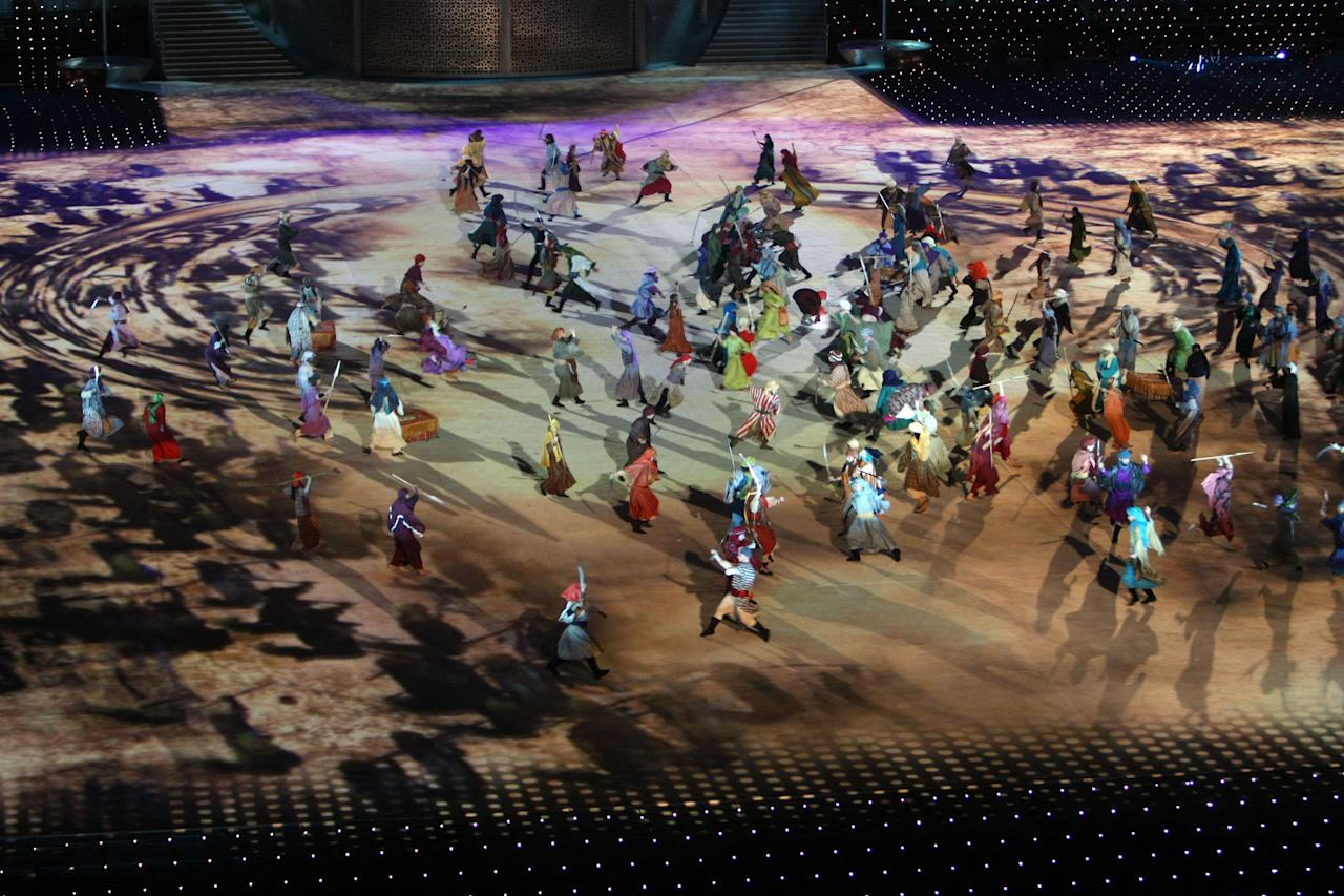 Actors perform during the opening ceremony of the pan-Arab Games in the Qatari capital Doha on Friday Dec 9, 2011 . More than 5,000 Arab athletes are participating in the Arab games from Dec 9 to 24. (AP Photo/Osama Faisal)