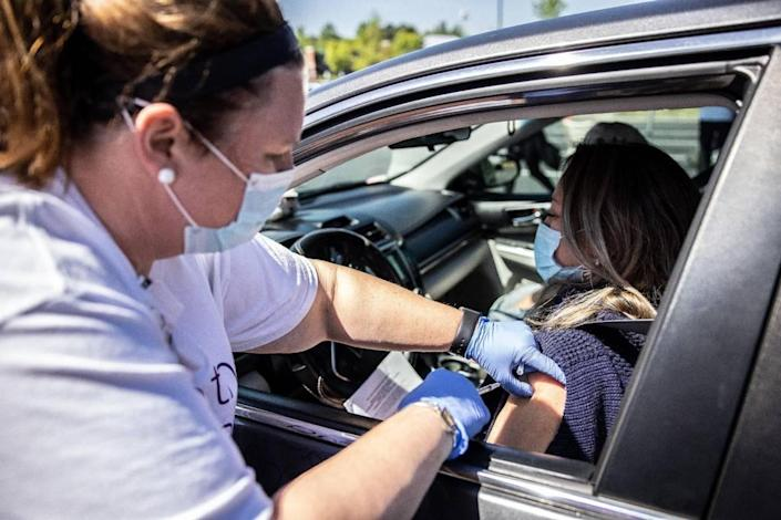 A scene from Novant Health's mobile unit for COVID-19 vaccinations at Lowe's at Northlake in Charlotte, N.C., on Tuesday, April 27, 2021.