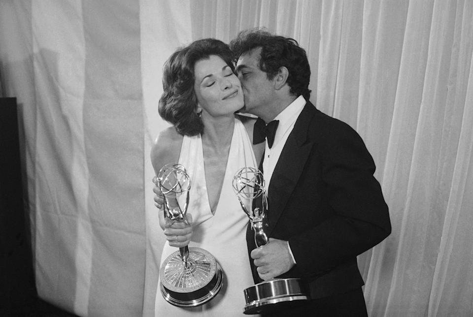 """Peter Falk of """"Columbo"""" gives Jessica Walter of """"Amy Prentice"""" a kiss after both won Emmys on Monday, May 19, 1975. Falk was named best actor in a lined series while Walter won for best actress in a limited series."""