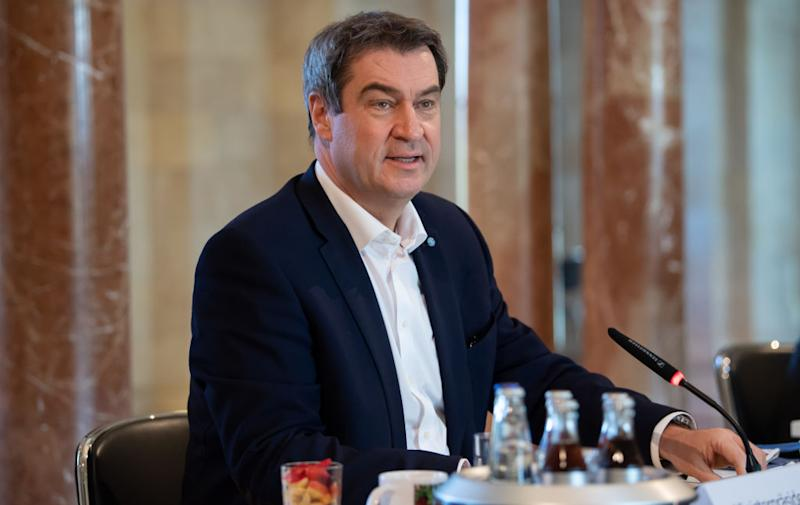 16 April 2020, Bavaria, Munich: Markus Söder (CSU), Minister President of Bavaria, is attending a meeting of the Bavarian cabinet. In order to keep more distance from each other, the cabinet meeting will take place in the large domed hall of the Bavarian State Chancellery. The focus of the meeting is the Corona crisis. Photo: Sven Hoppe/dpa (Photo by Sven Hoppe/picture alliance via Getty Images)