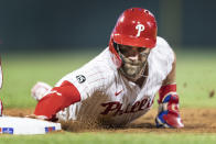 Philadelphia Phillies' Bryce Harper is safe on a pickoff-attempt at first base during the seventh inning of a baseball game against the Washington Nationals, Monday, July 26, 2021, in Philadelphia. (AP Photo/Laurence Kesterson)
