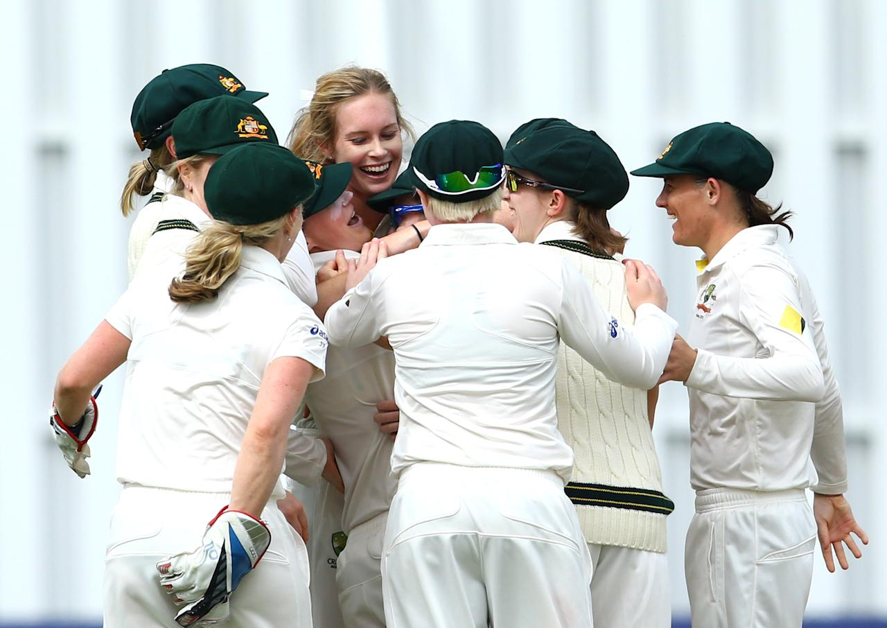 HIGH WYCOMBE, ENGLAND - AUGUST 14:   Ellyse Perry of Australia celebrates the run out of Heather Knight of England with team-mates during day four of the Women's Ashes Series match between England and Australia at Wormsley Cricket Ground on August 14, 2013 in High Wycombe, England.  (Photo by Jan Kruger/Getty Images)
