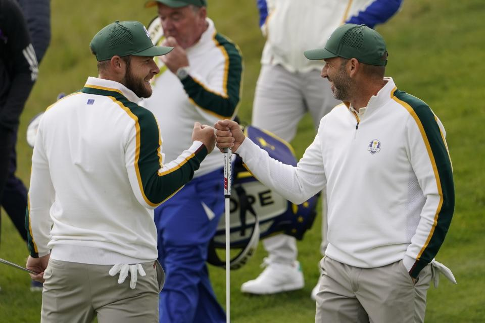 Team Europe's Sergio Garcia and Team Europe's Tyrrell Hatton fist pump on the sixth hole during a practice day at the Ryder Cup at the Whistling Straits Golf Course Wednesday, Sept. 22, 2021, in Sheboygan, Wis. (AP Photo/Jeff Roberson)