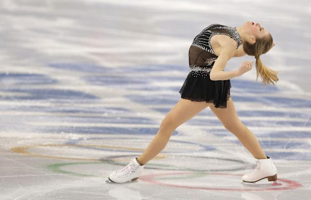 Ashley Wagner of the United States competes in the women's short program figure skating competition at the Iceberg Skating Palace during the 2014 Winter Olympics, Wednesday, Feb. 19, 2014, in Sochi, Russia. (AP Photo/Vadim Ghirda)