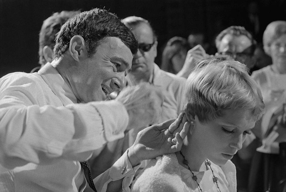 <p>Celebrity hairstylist, Vidal Sassoon, cuts Farrow's famous pixie in front of the press, as the actress prepares for her upcoming role in <em>Rosemary's Baby</em>. </p>