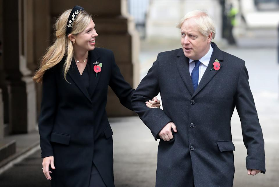 Prime Minister Boris Johnson with partner Carrie Symonds, on their way to meet veterans, following the National Service of Remembrance at the Cenotaph, in Whitehall, London.