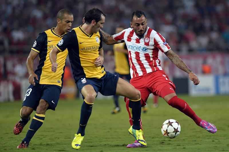Image result for olympiacos atletico de madrid 2014