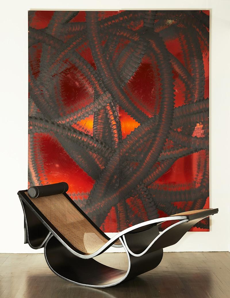 An Oscar Niemeyer chaise with an untitled 2010 work by Aaron Young inside a New York residence on Wooster Street.