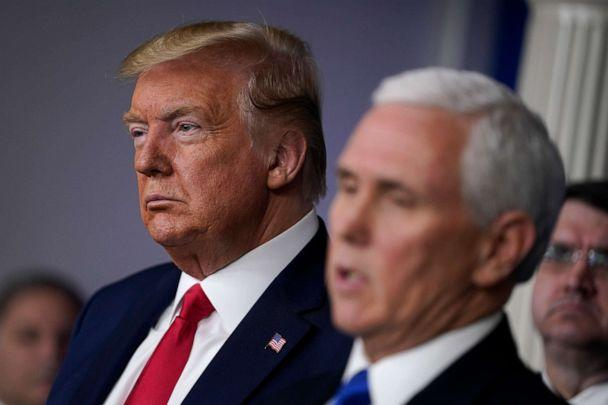 PHOTO: President Donald Trump listens as Vice President Mike Pence speaks during press briefing with the Coronavirus Task Force, at the White House, March 18, 2020, in Washington. (Evan Vucci/AP)