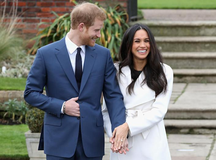 Meghan chose a wrap coat as she and Harry confirmed their engagement later in 2017. (Getty Images)