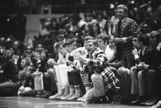 FILE - In this March 23, 1974, file photo, North Carolina State basketball coach Norm Sloan gestures from the bench during their double overtime 80-77 victory over UCLA in a semifinal game at the NCAA college basketball championships in Greensboro, N.C. (AP Photo/File)
