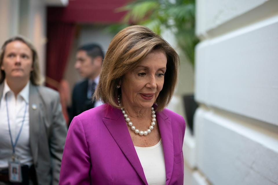 House Speaker Nancy Pelosi, D-Calif., arrives for a closed-door session with her caucus before a vote on a resolution condemning what she called