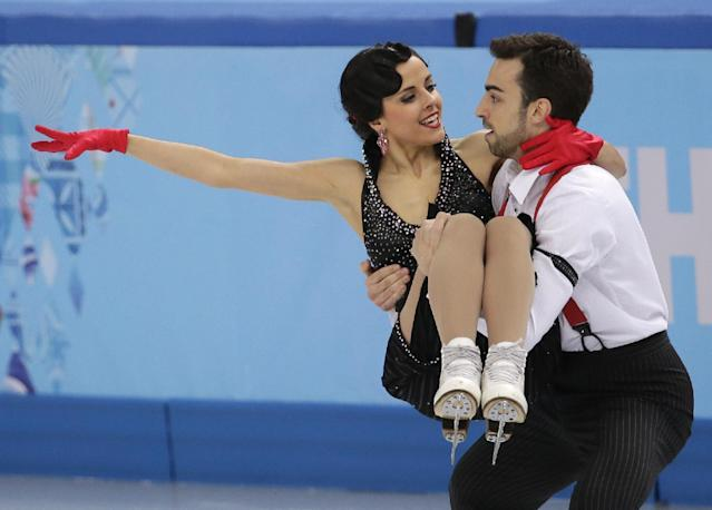Sara Hurtado and Adria Diaz of Spain compete in the ice dance short dance figure skating competition at the Iceberg Skating Palace during the 2014 Winter Olympics, Sunday, Feb. 16, 2014, in Sochi, Russia. (AP Photo/Bernat Armangue)
