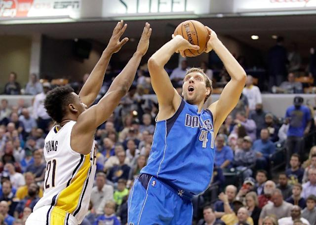 Dirk Nowitzki (right) says he could retire as early as next year, but admits his dream is to play until 2018 (AFP Photo/Andy Lyons)