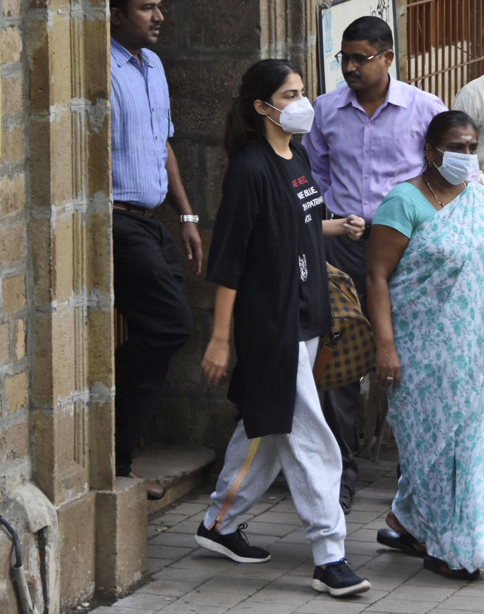 Bollywood actor Rhea Chakraborty walks out of the Narcotics Control Bureau (NCB) office to be taken for a medical check, in Mumbai, India, Tuesday, Sept. 8, 2020. The Bollywood actress who was arrested by India's narcotics agency, setting off a media frenzy that has gripped the nation, walked out of jail on Wednesday, Oct. 7, after being granted bail. Chakraborty was released from Bycula District Prison in Mumbai a month after being arrested for allegedly buying drugs for her boyfriend, popular movie actor Sushant Singh Rajput, who was found dead in a suspected suicide in June. (AP Photo/Bhushan Koyande)