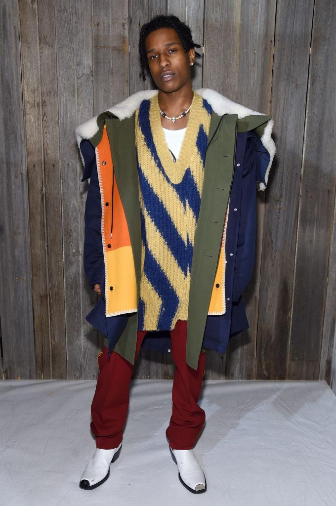 <p>ASAP Rocky attended the Calvin Klein show and demonstrated how to rock this season's coolest trend, the cowboy boot. <em>[Photo: Getty]</em> </p>