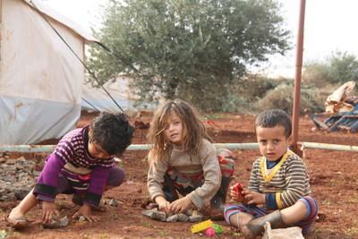 Children playing with toys near their tent at a displacement camp in Northwest Syria. (CNW Group/World Vision Canada)