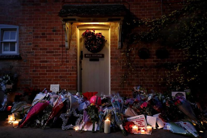 Shock: Flowers outside the Goring house of George Michael in Oxfordshire (PA)