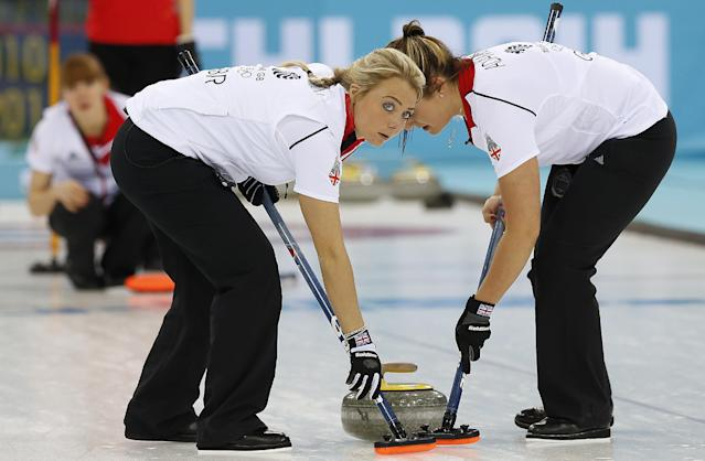 Britain's Anna Sloan, left, and Vicki Adams, right, sweep the ice during the women's curling competition against China at the 2014 Winter Olympics, Thursday, Feb. 13, 2014, in Sochi, Russia. (AP Photo/Wong Maye-E)
