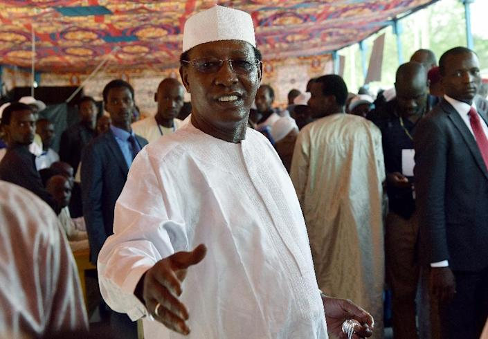 Chad's President Idriss Deby arrives to cast his ballot at a polling station in N'Djamena on April 10, 2016 (AFP Photo/Issouf Sanogo)