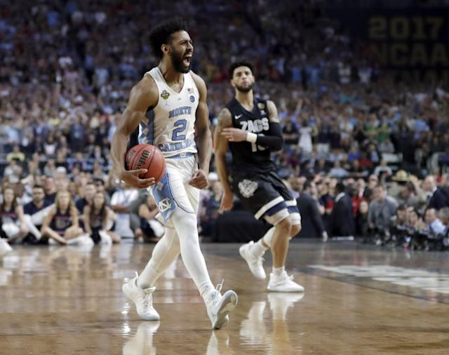 <p>North Carolina's Joel Berry II (2) celebrates after the finals of the Final Four NCAA college basketball tournament against Gonzaga, Monday, April 3, 2017, in Glendale, Ariz. North Carolina won 71-65. (AP Photo/David J. Phillip) </p>