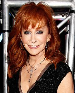 """Reba McEntire on Internet Death Hoax: """"I Am Alive and Kicking"""""""