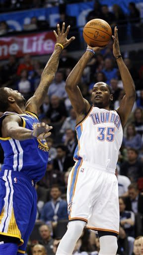 Oklahoma City Thunder forward Kevin Durant (35) shoots in front of Golden State Warriors forward Dorell Wright, left, in the first quarter of an NBA basketball game in Oklahoma City, Friday, Feb. 17, 2012. (AP Photo/Sue Ogrocki)