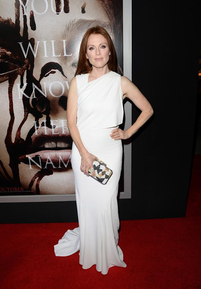 """HOLLYWOOD, CA - OCTOBER 07: Actress Julianne Moore arrives at the premiere of Metro-Goldwyn-Mayer Pictures & Screen Gems' """"Carrie"""" at ArcLight Cinemas on October 7, 2013 in Hollywood, California. (Photo by Jason Merritt/Getty Images)"""