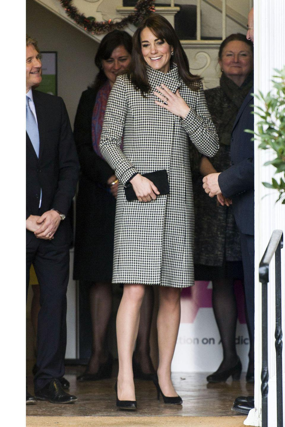 <p>The royal wears a black and white houndstooth Reiss coat, complete with black accessories. </p>