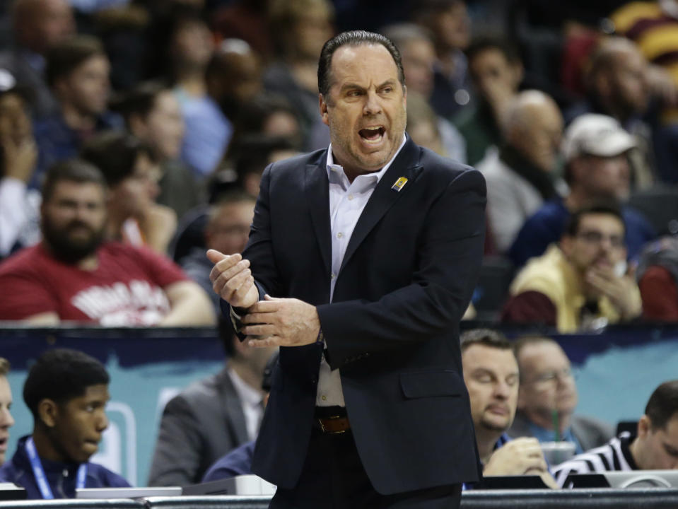 Notre Dame head coach Mike Brey calls out to his team during the first half of an NCAA college basketball game against Pittsburgh in the first round of the Atlantic Coast Conference tournament Tuesday, March 6, 2018, in New York. (AP Photo/Frank Franklin II)